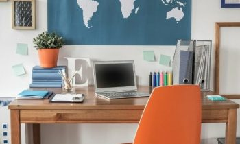 A styled office with world map background for the blog post Remote Bilingual Jobs You Can Do From Home