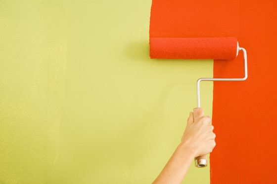 woman painting wall for blog post 30 service based business ieas