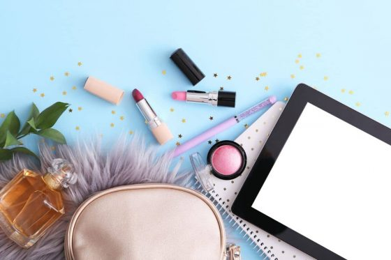 An assortment of cosmetics on the desk of a product tester