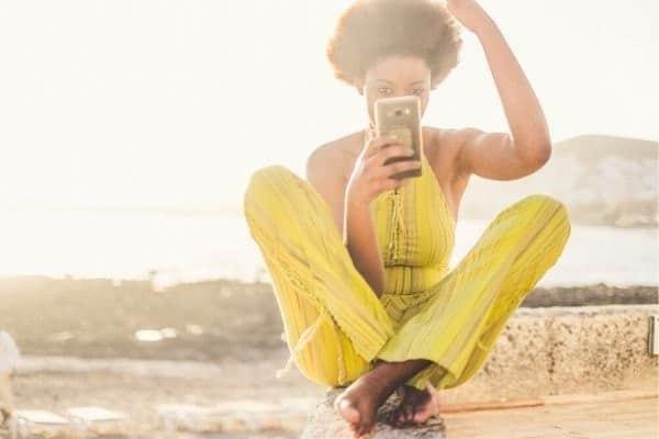 Woman creating video with TikTok on phone.