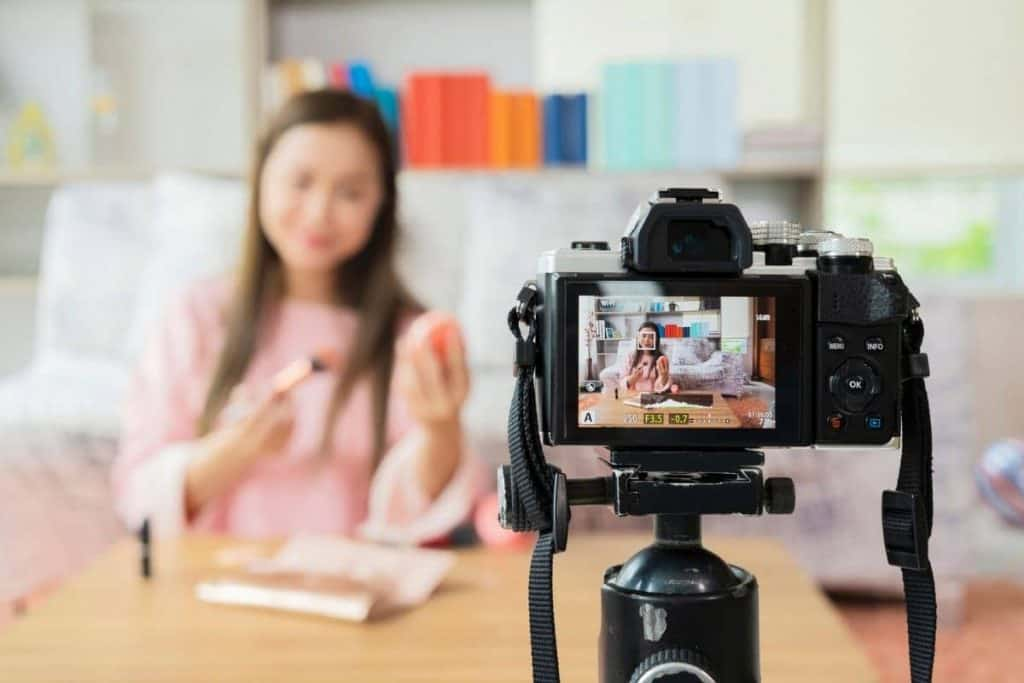 Woman influencer filming video for YouTube