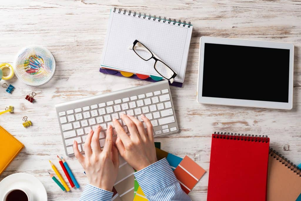 woman freelance writing and design in home office