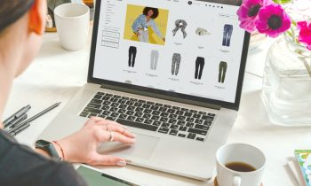 cabi stylist on a laptop working