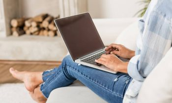 woman on laptop making money surfing the web