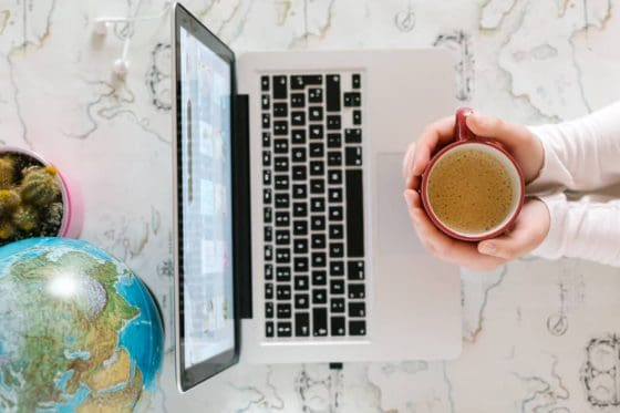 remote jobs listed by state picture of a woman, laptop, and globe